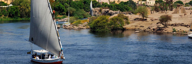 Aswan, Felucca and the Aga Khan Mausoleum on the West Bank